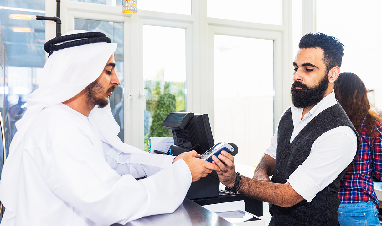 Merchant Accepting an International Traveler's Credit Card Payment using Elavon's Dynic Currency Payment Solution